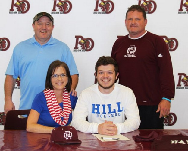 Red Oak High School Senior Keyton McMillion posing with parents Brent and Kerri and ROHS Head Baseball Coach Jay Johnson after signing to play baseball with Hill College in the fall of 2015.