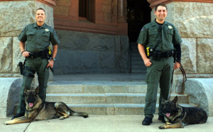 Corporal Mike McCorkle and his canine Riko (left) and Deputy Klinton Valley and his canine Blade (right) of the Ellis County Sheriff's Office.