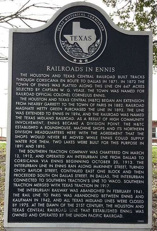 The Railroads in Ennis historical marker was erected in 2000 at Pierce Park near NW Main & US 287 in Ennis.