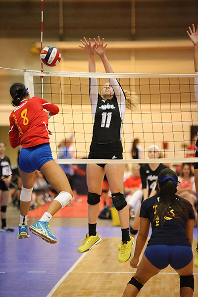 Waxahachie Indian varsity volleyball player Shelby Martin #11 playing on team Club Skyline during the USA Volleyball 2015 Girls Junior National Championship in New Orleans.