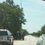 A nearby resident photographed Sheriff's Deputies and media stationed down the street from Maximum K-9 in Waxahachie, TX.