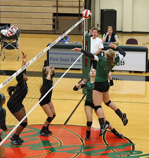 #4 Abi Rodgers (Sr) sets #15 Audrey Nalls (Fr). The Waxahachie Lady Indians varsity volleyball squad defeated Poteet 3-1 on Tuesday, August 18, 2015. — Photo by Mark Martin. Follow Mark on Twitter @NdnVolleyball.